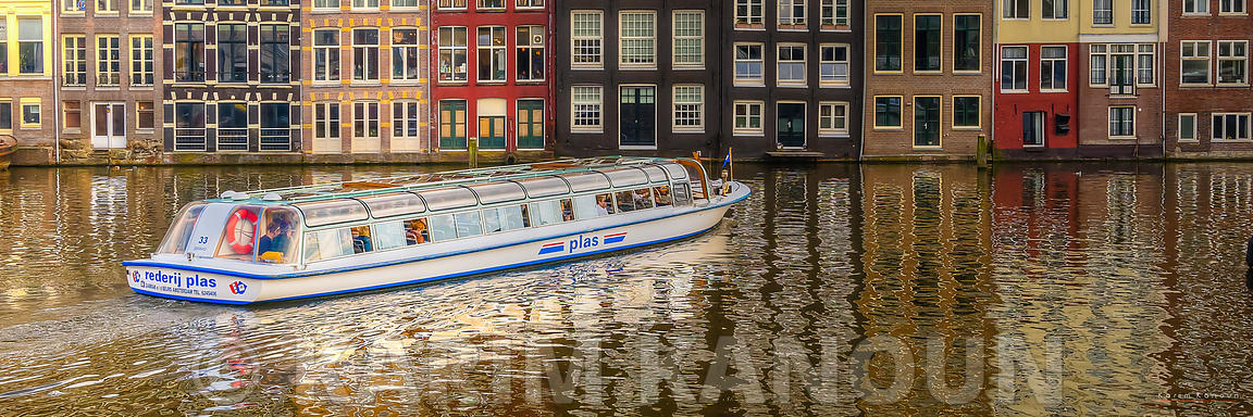 Panorama -  Colorful Amsterdam river reflection with a boat