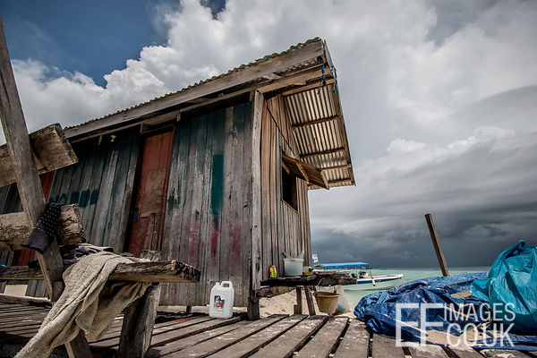 Wooden Shack On A Tropical Island Jetty
