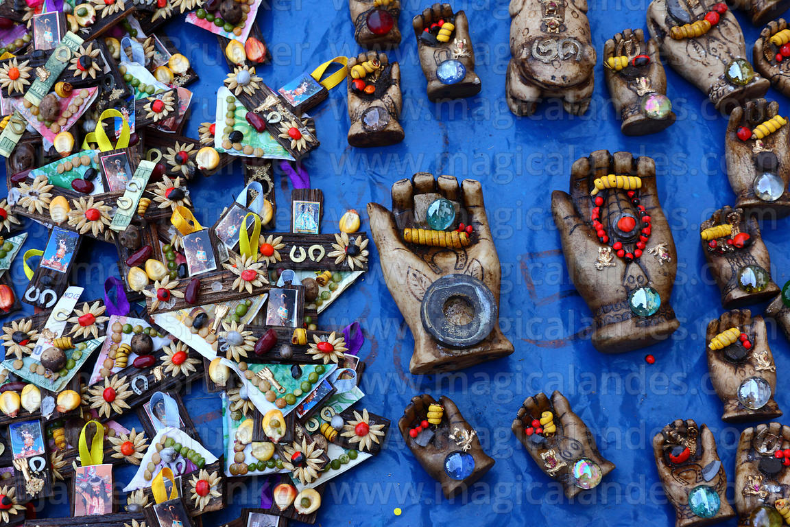 Miniature wooden crosses and hand symbols for sale in market for Alasitas festival, Puno, Peru