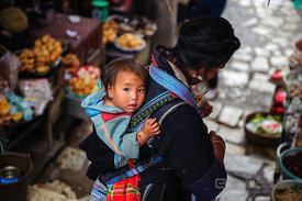 Young Hmong Child on Back of Sapa Woman at Market