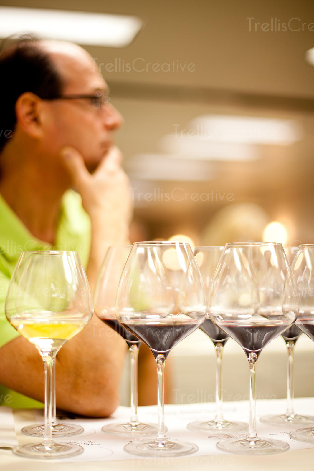 Man in front of wine glasses