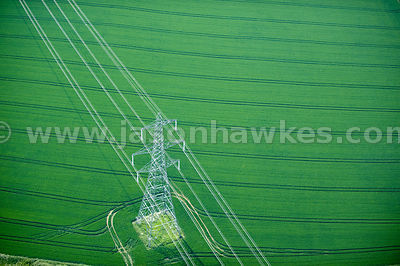 Aerial view of electric Pylon in fields near Littlebury, Essex