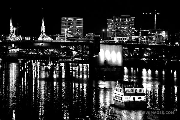 BOAT APPROACHING MORRISON BRIDGE WILLAMETTE RIVER DOWNTOWN PORTLAND OREGON AT NIGHT BLACK AND WHITE