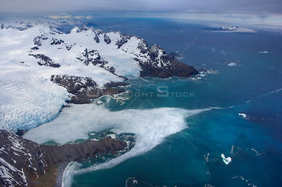 Aerial view of the east coast showing Keilhau Glacier looking towards Annenkov Island, South Georgia, Antarctica, December 2006