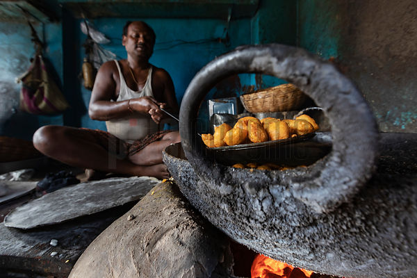 Vendor at the Maniktala Market Prepares Potato Fritters (Aloo Bonda) in a Kadhai