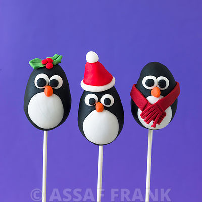 Three penguin pop cakes