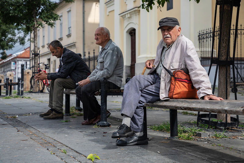 Men Sitting on a Bench in the Central Square of Zemun