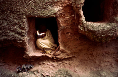 Ethiopia - Lalibela - A hermit in his cave in the walls of Bet Gioris