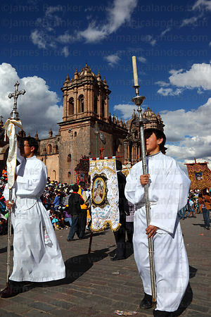 Priest carrying silver cross during parades for Corpus Christi festival , Plaza de Armas , Cusco , Peru