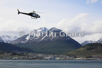 Expedition Aerospatiale helicopter LV-CUS about to land on cruise vessel Ortelius (Oceanwide Expeditions) with Ushuaia behind...