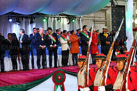 Members of the Los Colorados presidential regiment parade past Bolivian president Evo Morales Ayma and officials on the official podium during the Desfile de Teas / Torch Parade to commemorate the July 16th 1809 uprising, La Paz, Bolivia
