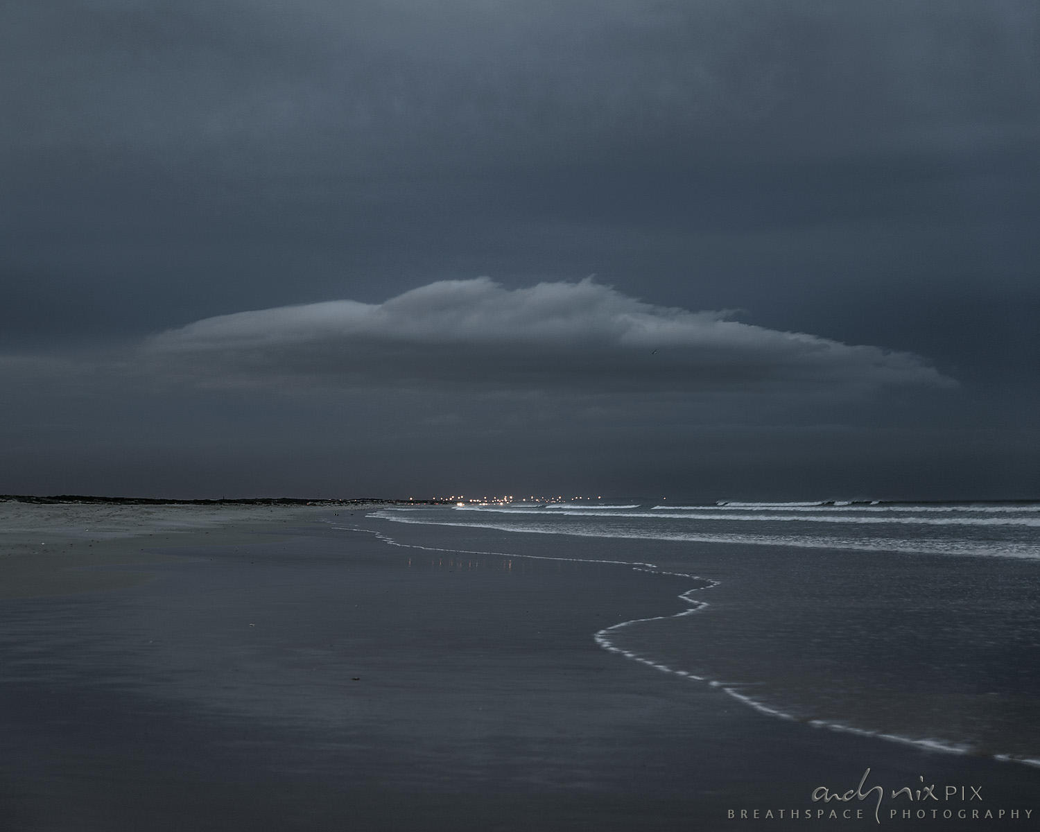 Flying saucer cloud over beach