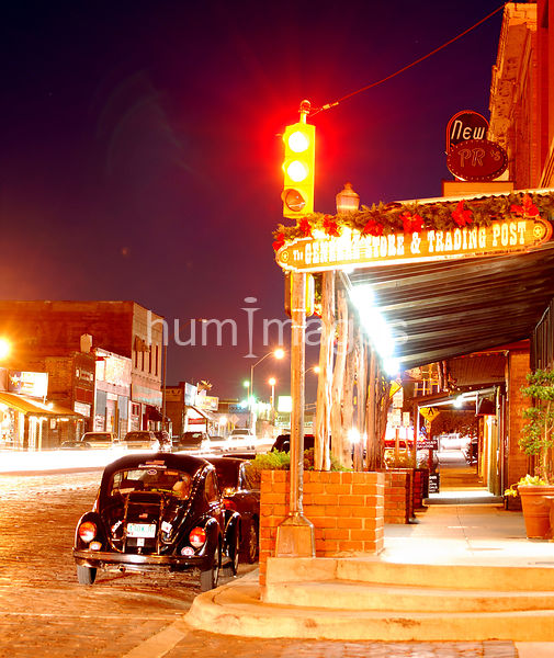 Street corner at night in Stockyards area of Ft. Worth, Texas (Volkswagen Bug)