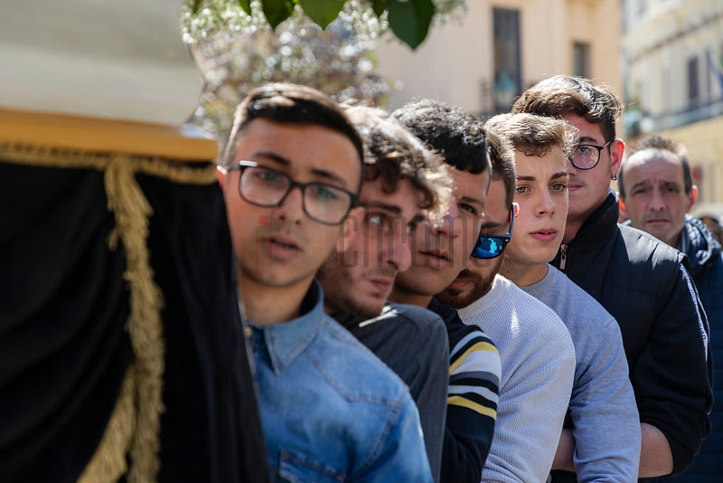 Young Men Carrying a Statue of the Virgin in a Parade in the Streets of Trapani during the lead-up to The Processione dei Mis...