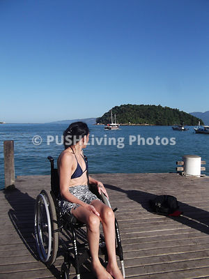 Woman in wheelchair on a pier