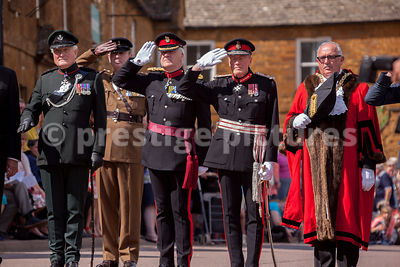 Senior officers and dignitaries take the salute