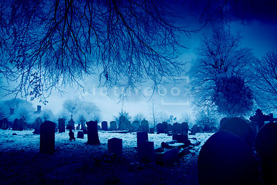 An atmospheric image of an old churchyard on a winters evening.