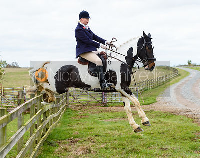 Agnes Linnea jumping a hunt jump at Stone Lodge. The Cottesmore Hunt at Tilton