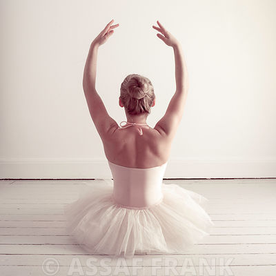 Rear view of professional ballet dancer dancing