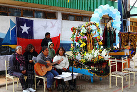 Music group playing during holy communion during mass for St Peter and St Paul festival, Arica, Chile
