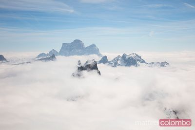 Mountain peak emerging from the clouds, Dolomites