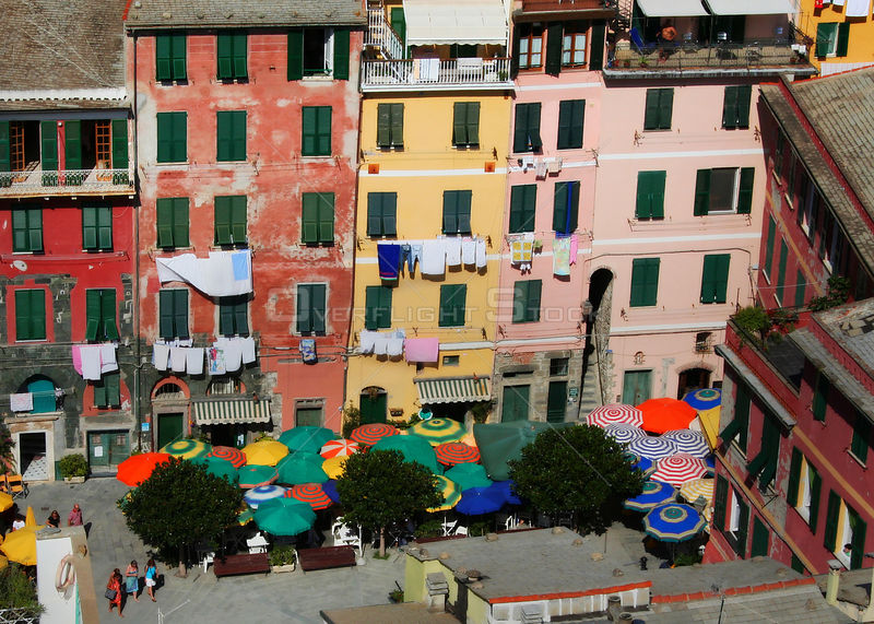 Piazza with colourful buildings and parasols, Vernazza, Cinque Terre, Italy, 2006.