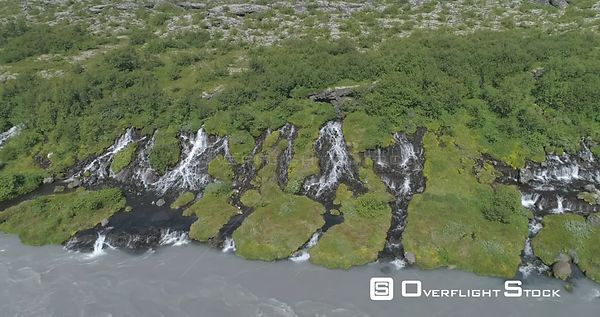 Flying Slowly Over Hraunfoss Lava Spring Waterfall Glacial River Iceland Drone Aerial 4k