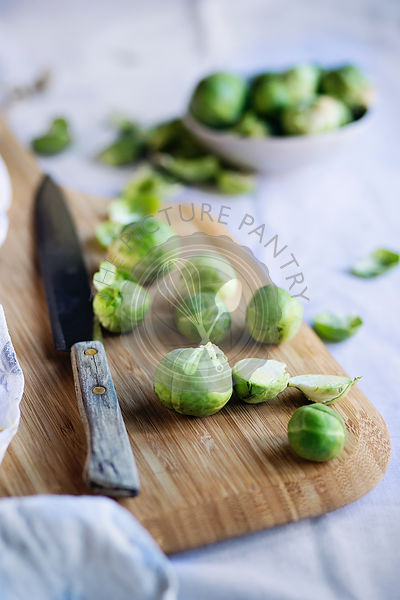 Brussels sprouts on wooden cutting board