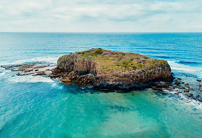Stack Island lies about 300m off the coast at Minnamurra and has interesting varyiation layers in rock colourings. NSW Australia
