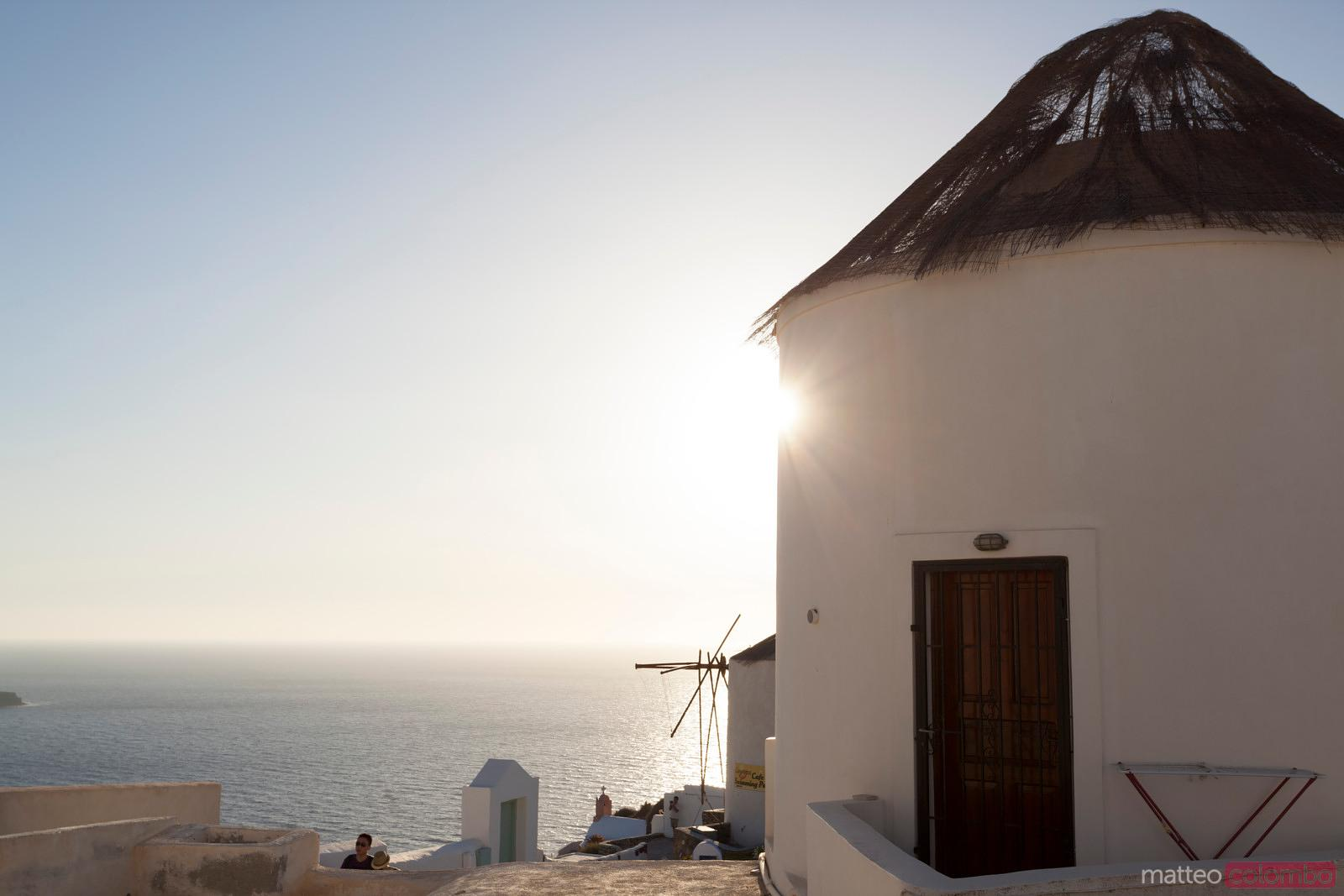 Traditional windmills of Oia Santorini at sunset