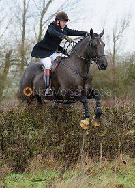 Roger Weatherby jumping a hedge near Mrs Wilson's covert