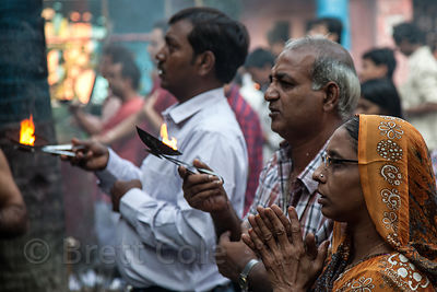 Hindu devotees pray during the Durga Puja festival, at a temple near Barabazar on the Ganges River, Kolkata, India.