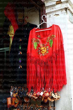Embroidered shawl or manta hanging outside shop, Tarija, Bolivia