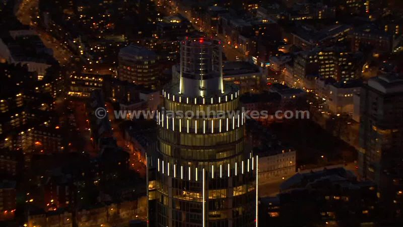 Aerial footage of St George Wharf Tower at night, London