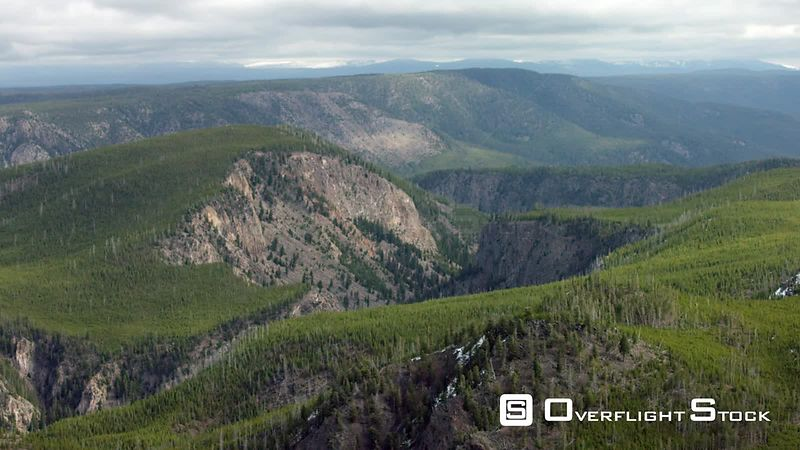 Steep cliffs and dense lodgepole pine forests on the western edge of Yellowstone National Park, Wyoming