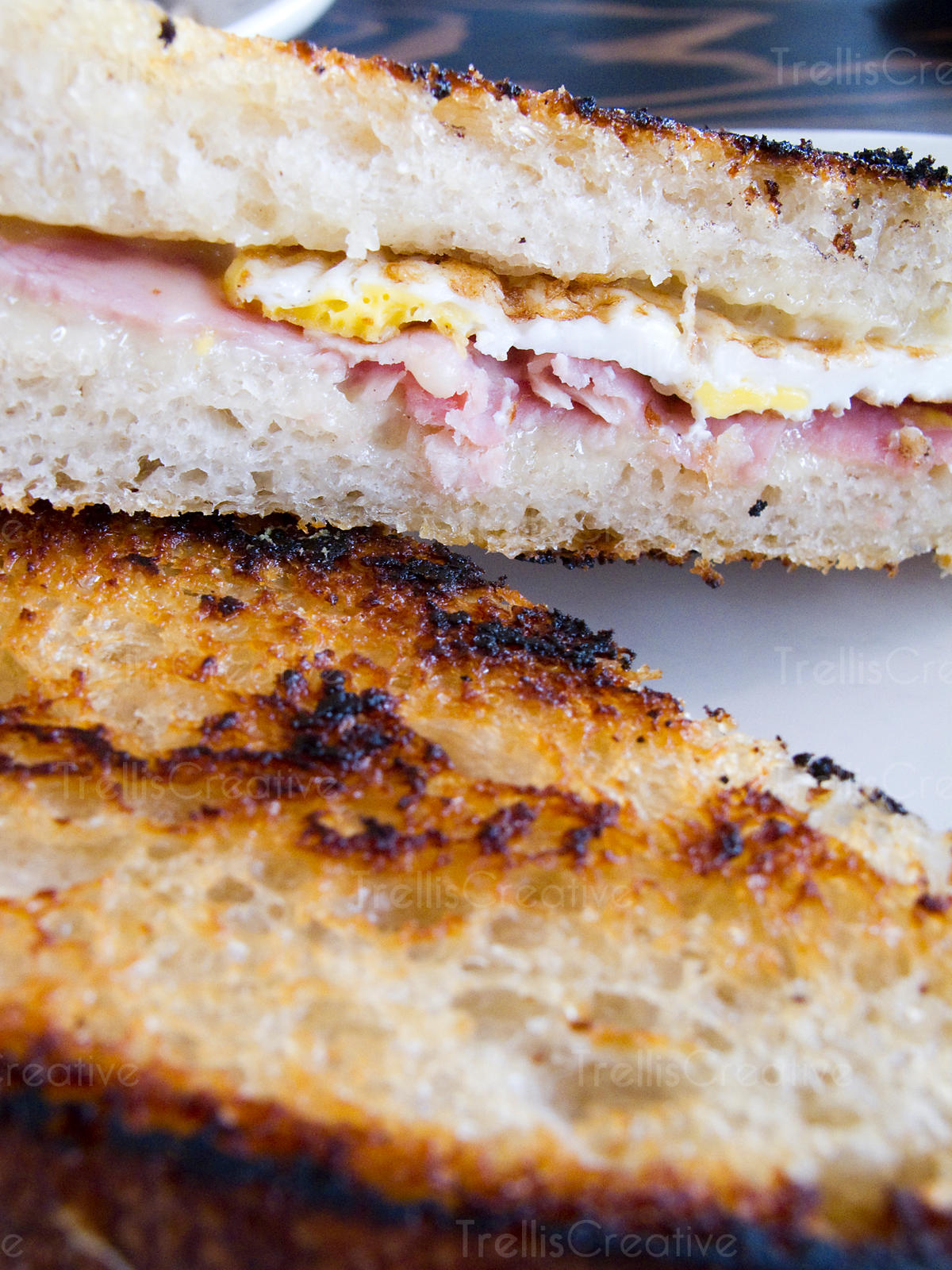 Close-up of a fried egg and ham sandwhich
