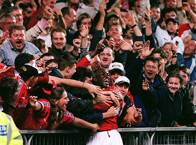 Dwight Yorke being hugged by fans