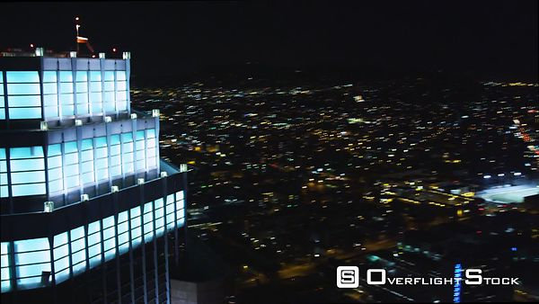 Flying Past Los Angeles Skyscrapers at Night.