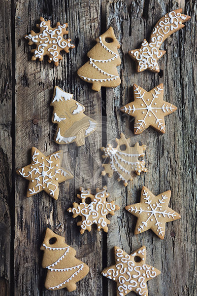 Decorated Christmas gingerbread cookies on wooden table