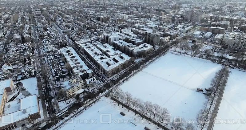 Aerial High Above Brooklyn Snowy Rooftops Streets and Football Fields Winter