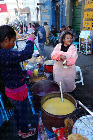 Woman preparing buñuelos, typically served with api , La Paz , Bolivia