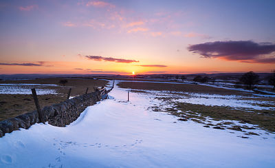 Sunset snow and bird tracks on Eyam Moor