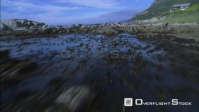 Aerial shot over a rocky coastline and out to sea. Eastern Cape South Africa