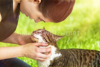 Woman Petting Cat Outdoors
