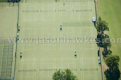 Aerial view over sports pitches and tennis courts