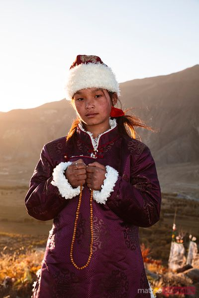 Young tibetan girl with prayer beads, Tibet