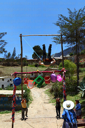 Man on a wallunk'a / swing during Todos Santos festival, Morochata, Cochabamba Department, Bolivia