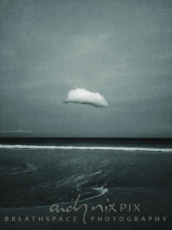 Lone cloud wandering over the sea