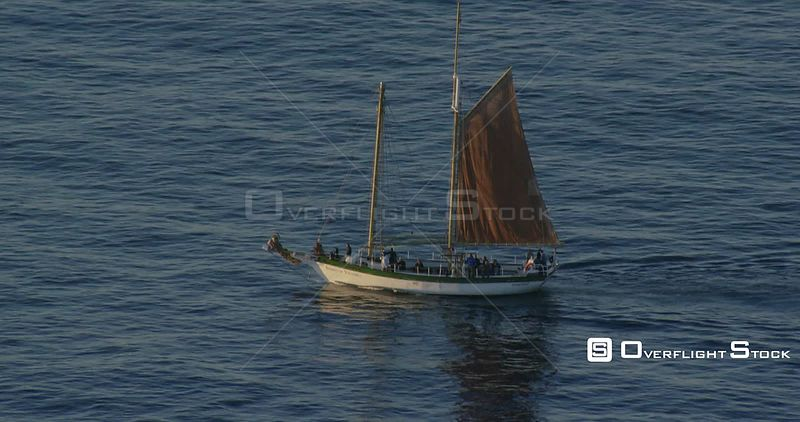 Aerial shot of a sail boat drifting out at sea. Western Cape South Africa
