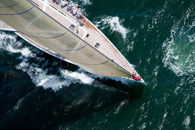 Aerial view of crew hiking out aboard the yacht Selene racing in the Newport Bucket, Rhode Island, USA, July 2009.